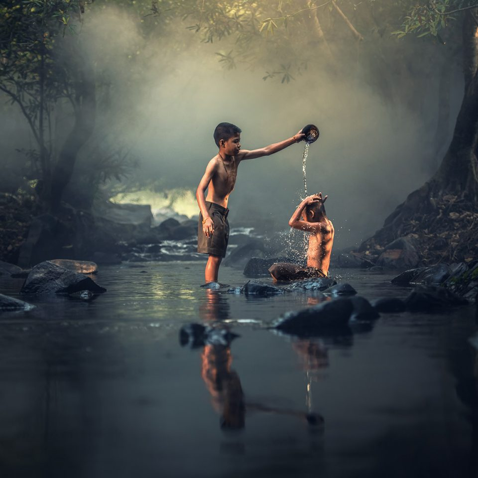 Children Playing in a River